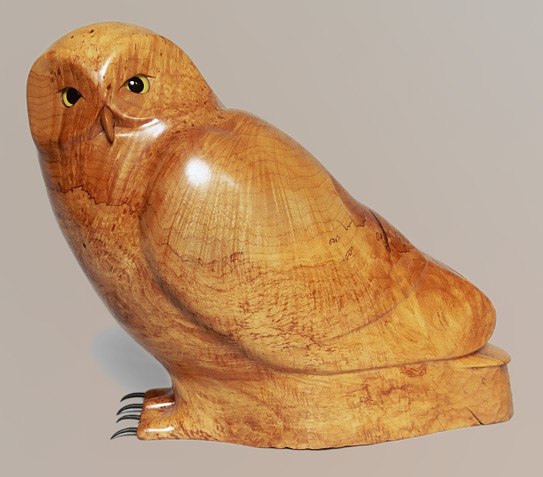 Snowy owl carved from maple burl